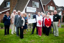 WS-PPG present cheque to Save the Children