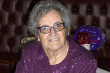 Resident poet Gwen Hulland at the Caring Café Christmas Meal
