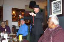 Magician Pat Kiely at the Caring Café Christmas Meal