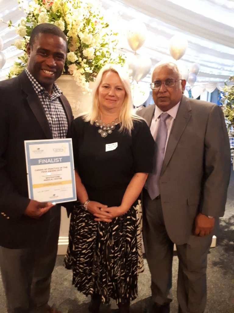 caring cafe receiving certificate at carer's trust award night