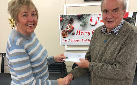 WS-PPG Chair Tricia Lawlor presenting funds raised to the Alzeimers Society